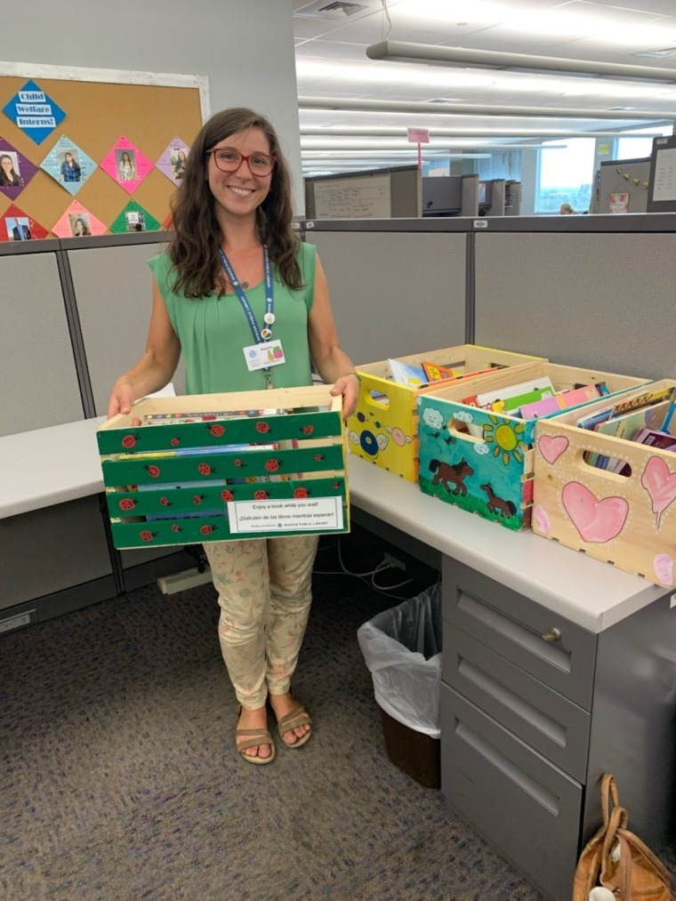 Natalie Magnatta with some book boxes!