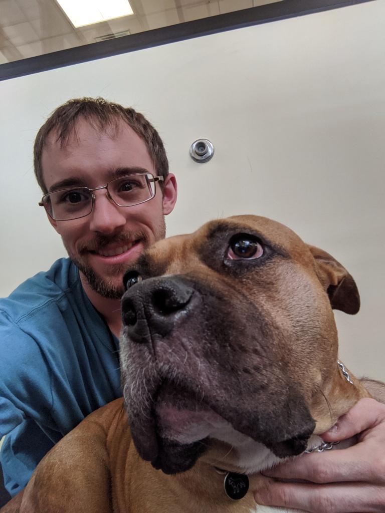 Derek Scott pictured with a dog.