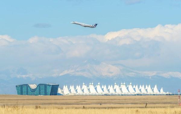 Airplane flying over Denver International Airport